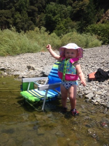 Cassidy waiving in the river.